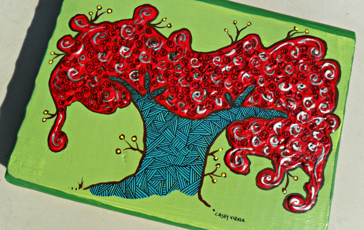 royal poinciana tree on wood block